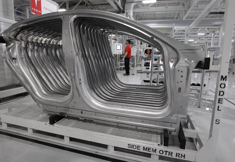 Tesla Model S frames sit in the assembly area at the Tesla factory in Fremont, Calif. U.S. manufacturing declined in June for the first time in nearly three years, a report said Monday.