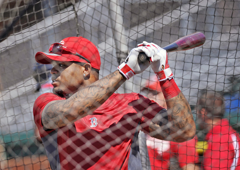 Boston's Carl Crawford, a $142-million outfielder on the disabled list, takes batting practice at Hadlock Field on Monday. Crawford underwent arthroscopic surgery on his left wrist in January to remove damaged tissue.