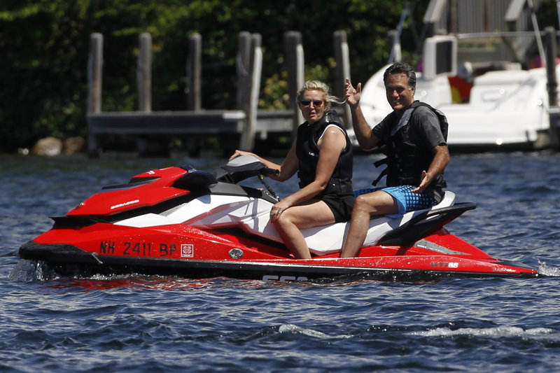 Presidential candidate Mitt Romney and his wife, Ann, take a ride on Lake Winnipesaukee in Wolfeboro, N.H., on Monday.