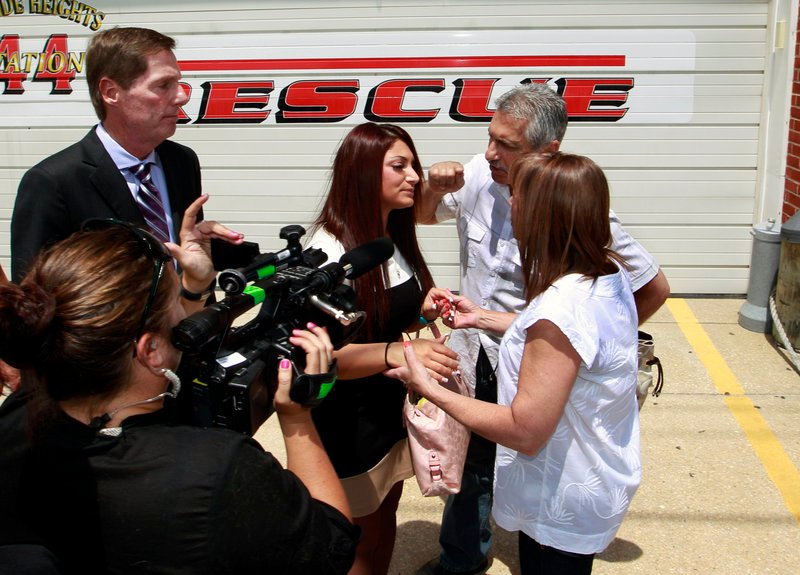 """""""Jersey Shore"""" star Deena Cortese, center, listens to her parents, Joann and John Cortese, outside court Tuesday after pleading guilty to failing to use the sidewalk. Her lawyer, Michael Pappa, is at left."""