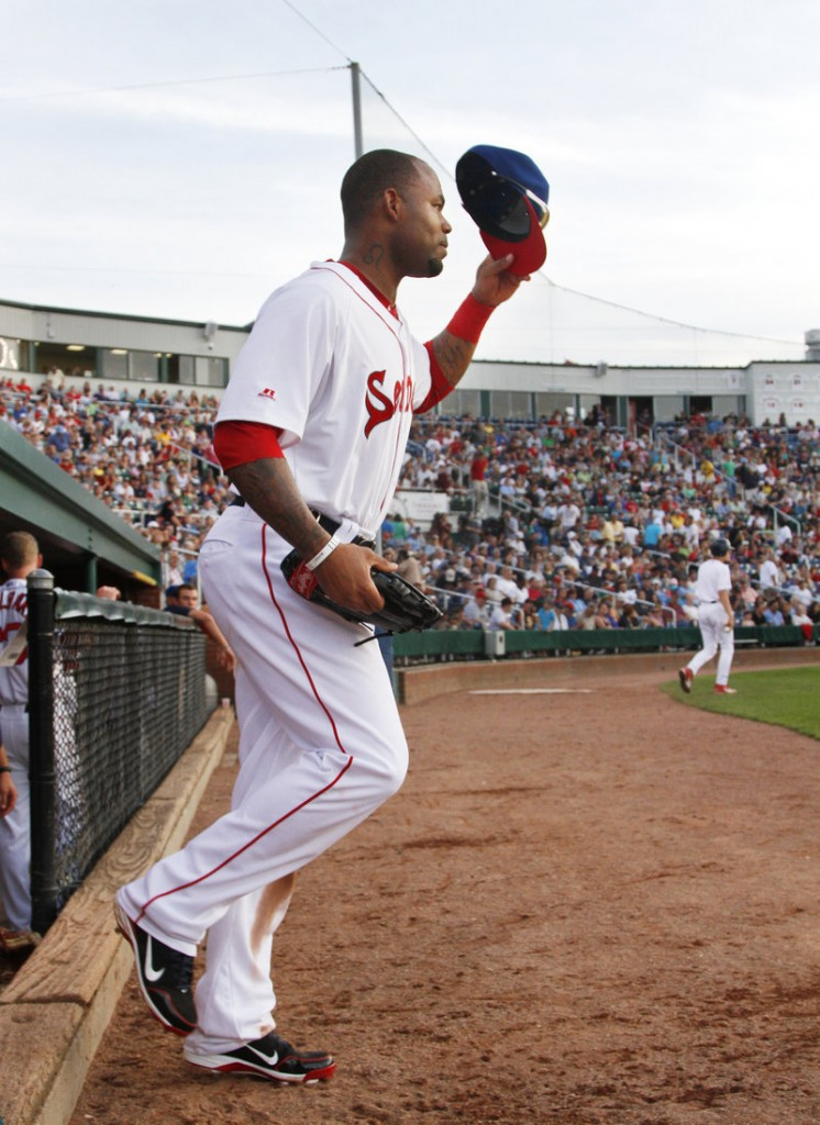 Carl Crawford tips his cap Tuesday night while taking the field for his first rehab appearance for the Portland Sea Dogs at a sold-out Hadlock Field. Crawford went 1 for 2 with two walks.