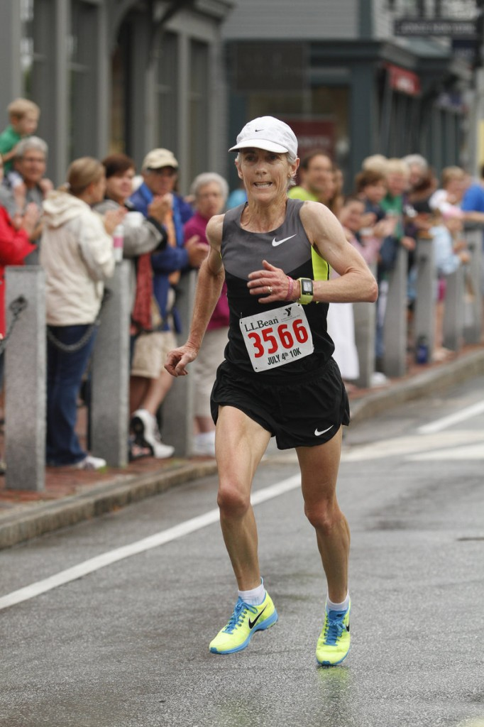 Joan Benoit Samuelson of Freeport finishes strong in fourth among women in the L.L. Bean 10K Road Race in Freeport.