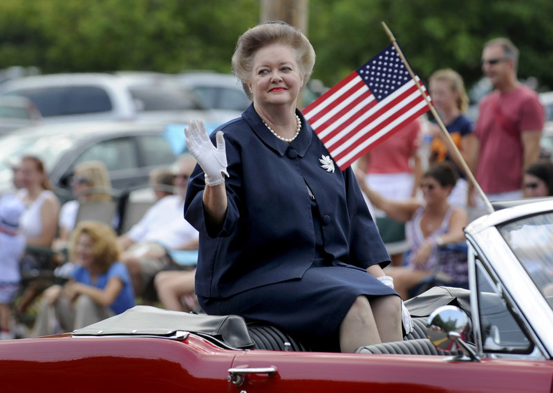 Georgia Branam with The Andy Griffith Show Rerun Watchers Club, Mayberry Chapter, waves to the crowd as she rides in the 25th annual Independence Day parade Wednesday in Farragut, Tenn.