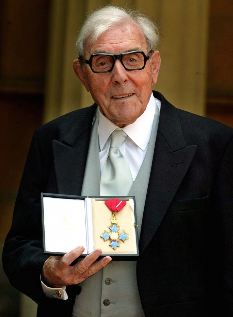 Eric Sykes, the veteran English comic actor and writer, holds the CBE, or Commander of the British Empire, award he received from Britain's Queen Elizabeth II at a Buckingham Palace investiture, in London in 2005. Sykes, who was one of the most popular comic actors of his generation, and appeared in shows in London's West End into his 80s, died Wednesday morning after a short illness. He was 89.