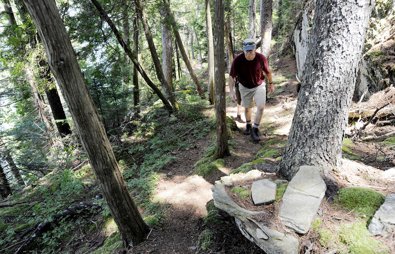 Don Miskill, a volunteer with the Harpswell Recreation Department and its former director, hikes the Devil's Back Trail on Orrs Island, which presents magnificent ocean views.