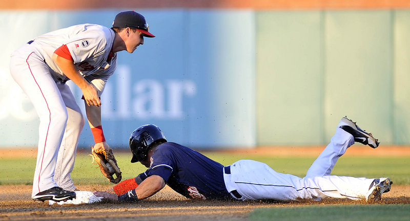 Brian Van Kirk of the New Hampshire Fisher Cats slides into second with a stolen base Thursday night as Nick Natoli of the Portland Sea Dogs applies the late tag.