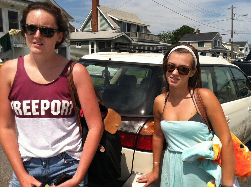 "Alice Gormley, 19, left, and Cara Yost, 19, of Freeport, say the won't come to Higgins Beach if they have to pay a $65 annual parking pass. ""It's ridiculous,"" Gormley said. ""I'm a college student and I'm kind of broke, and I won't be able to afford it."""