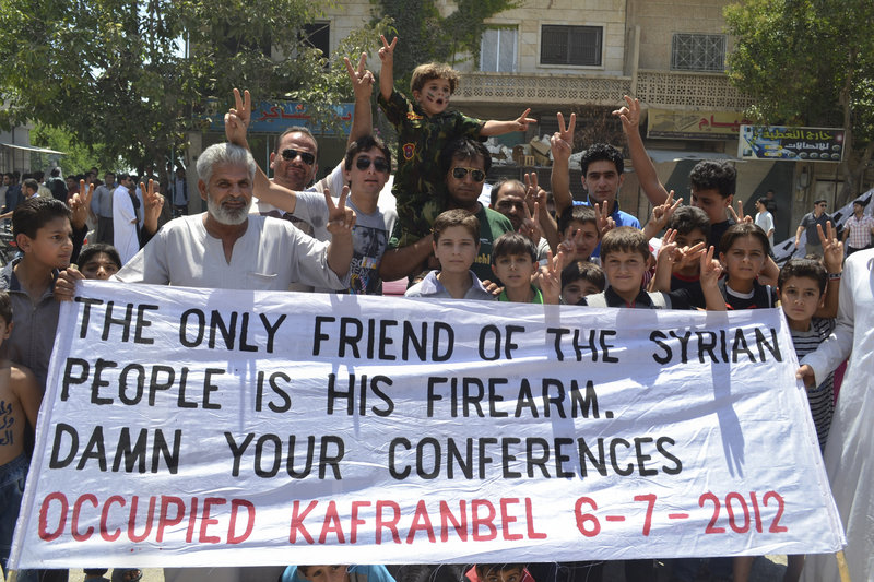 """This citizen journalism image taken Friday purports to show anti-Assad demonstrators in what they called a """"Friday of freedom from war"""" rally in Kafr Nabil, in northwestern Syria."""