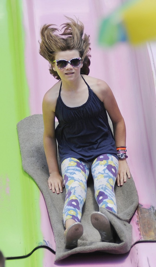 Katy Tucker, 10, of Bath rides down the super slide in the midway.