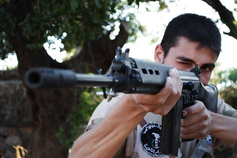 This citizen journalism image, taken July 4, purports to show a Free Syrian Army soldier aiming his weapon in the northern town of Sarmada, in Idlib province, Syria. The French foreign minister said Friday that the Syrian regime has killed at least 16,000 people.