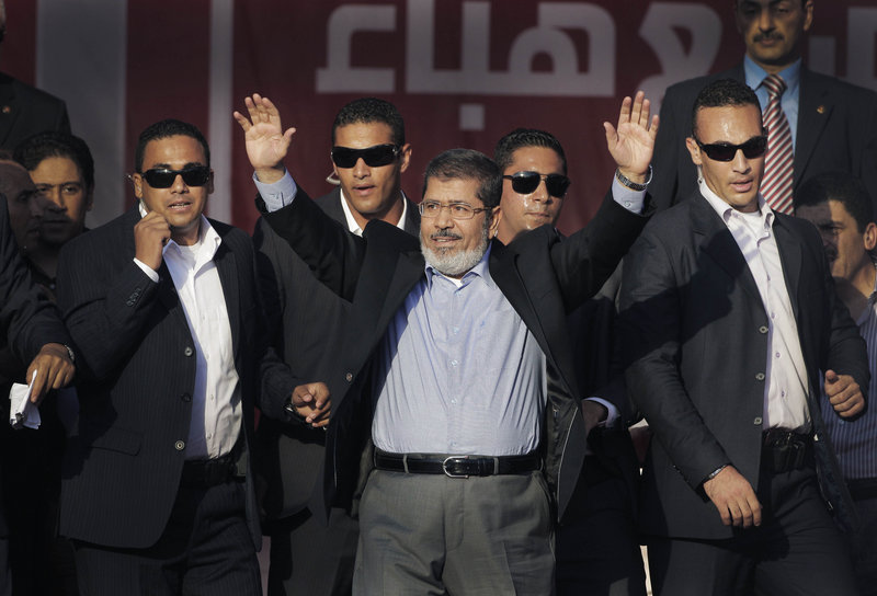 Egypt's new President-elect Mohammed Morsi waves to supporters at Tahrir Square, the focal point of Egyptian uprising, last month in Cairo, Egypt.