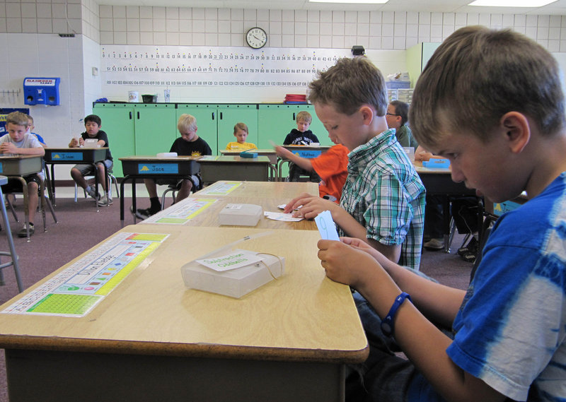 Dillon Elledge, 8, right, and Brody Kemble, 7, work with flash cards in their all-boys classroom at Middleton Heights Elementary in Middleton, Idaho, in May. The school originally piloted the idea as a way to address reading problems among boys, but has since expanded the concept.