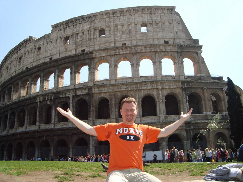 Brunswick native Tim Long wears his Moxie T-shirt at the Coliseum in Rome, above, and in the Sahara, below.