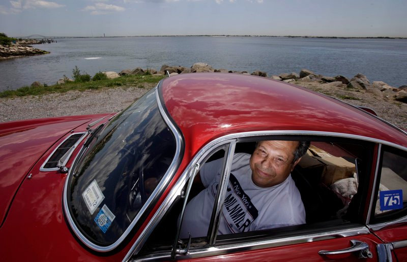 Irvin Gordon sits in his long-lived Volvo P1800S in Babylon, N.Y.