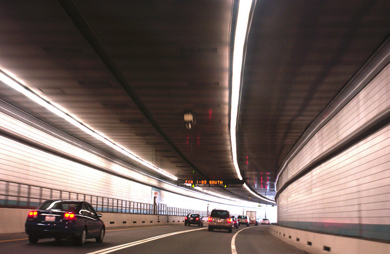 A two-lane exit leads out of a Big Dig tunnel onto I-93 South. During its building phase, the Central Artery/Tunnel Project was plagued with cost overruns and shoddy construction. The current debt and interest is preventing Massachusetts from funding other needed projects.