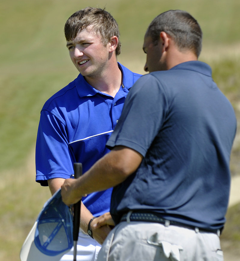 Seth Sweet of Madison, left, receives congratulations Thursday for winning the Maine Amateur from J.J. Harris, who tied for second. Sweet is heading to Old Dominion in the fall.