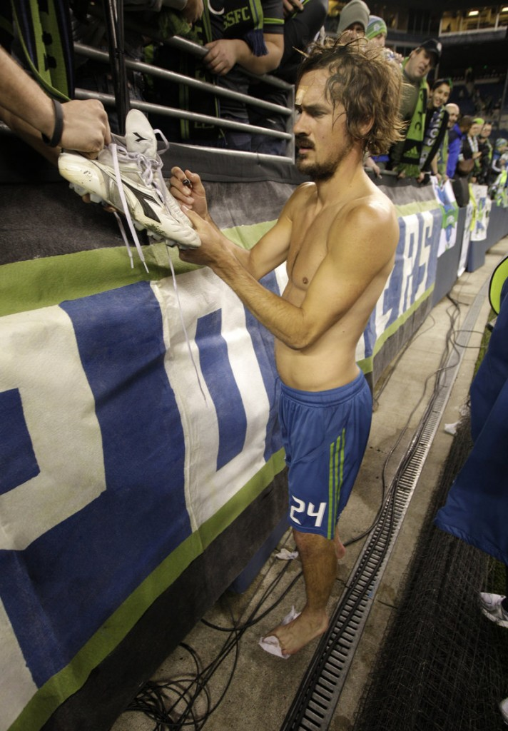 Roger Levesque, a former Falmouth High and Stanford University star, gives away his autographed shirt and shoes after a Seattle Sounders match earlier this year.