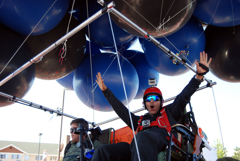 Iraqi adventurer Fareed Lafta, right, and gas station owner Kent Couch lift off Saturday from Couch's station in Bend, Ore., as they attempt to fly some 360 miles to Montana as a warm-up for a flight planned in Iraq.