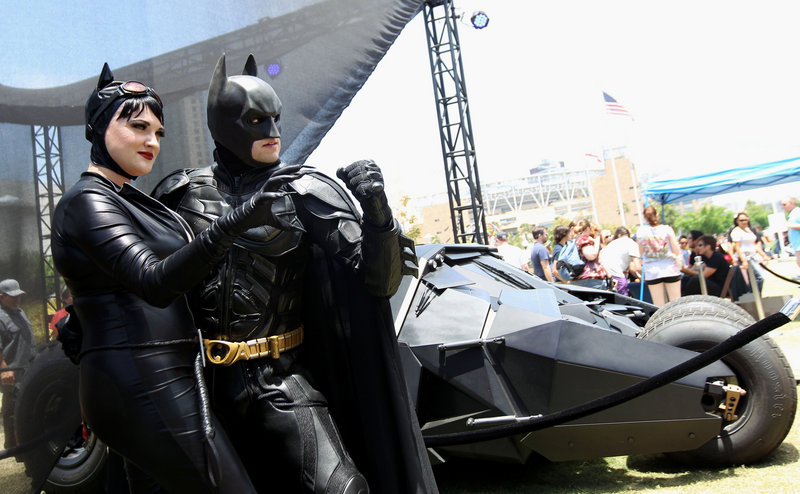 Katie Mitchell and Jonathan Graves of Los Angeles strike a pose in front of the Tumbler Batmobile at Comic-Con in San Diego on Saturday.