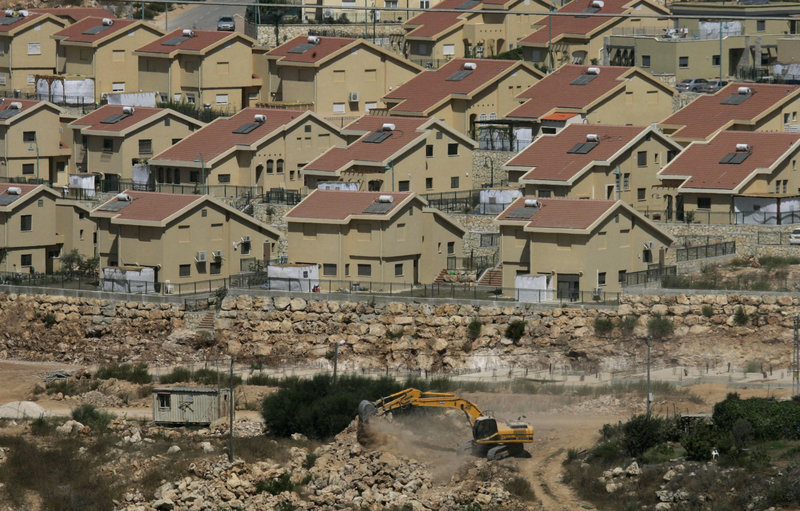 Israeli earth-moving equipment works in a settlement near the West Bank village of Salfit. Israel has agreed to grant subsidies for more than 500 new homes in the West Bank.