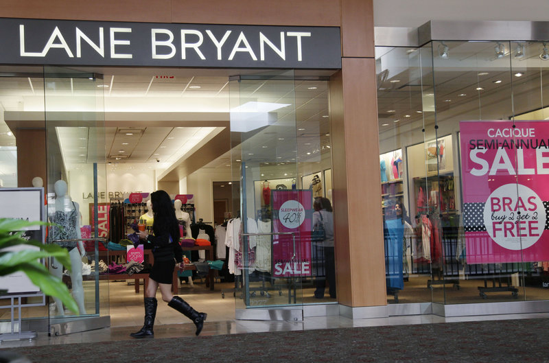 A woman walks into a Lane Bryant store in San Jose, Calif., last month. Americans spent less at retail businesses for a third straight month in June, the Commerce Department reported.