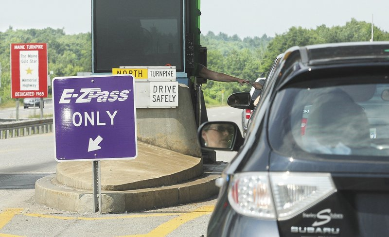 Motorists on I-295 northbund pass through the Gardiner toll booths Monday. Turnpike tolls are expected to increase starting in November to raise up to $26.5 million a year.