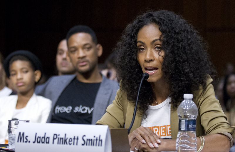 Jada Pinkett Smith, accompanied by her actor husband, Will Smith, and their daughter Willow Camille Reign Smith, left, testifies before the Senate Foreign Relations Committee on Tuesday.