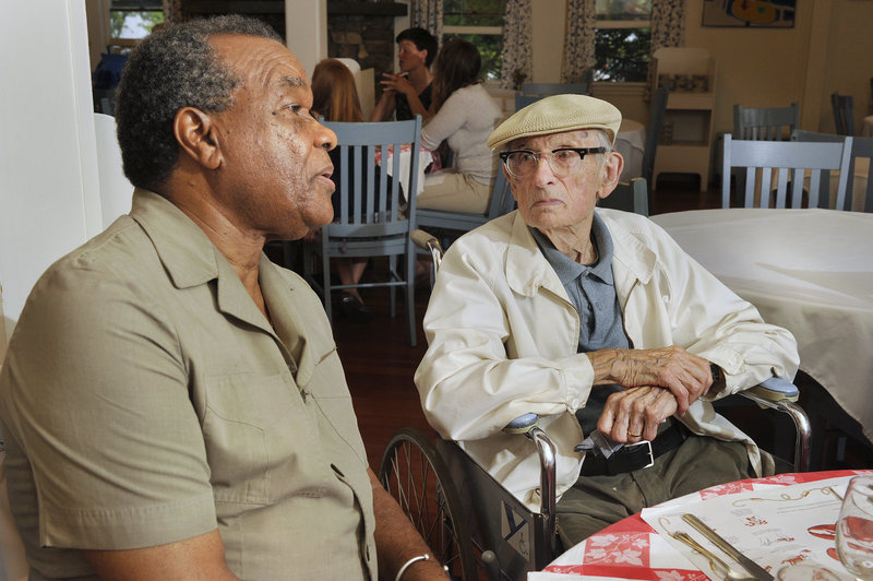 Artists David Driskell, left, and Will Barnet chat before dinner at the Rock Garden Inn in Georgetown recently.