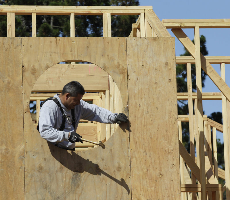 Home builder Mario Sanchez works on a home under construction in Palo Alto, Calif. Confidence among U.S. builders ticked up to a five-year high in June, an indication that the housing market is slowly improving.