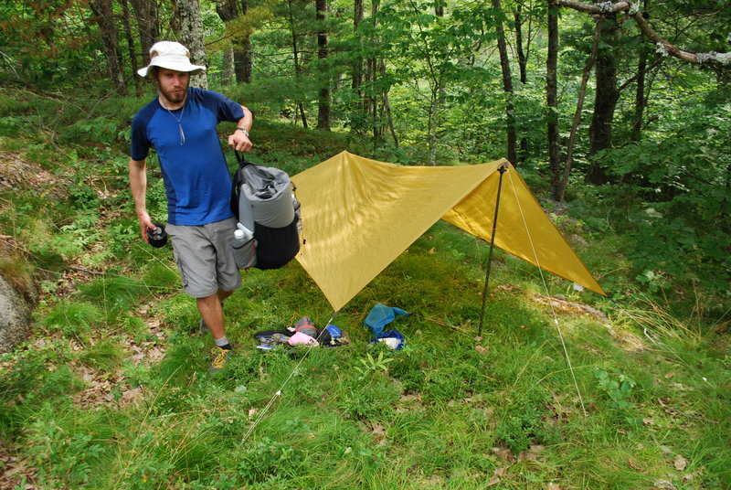 Ryan Linn sets up his tent with his ultra-light gear, which consisted of a light tarp, hiking poles and string. Linn said it's best to carry gear with multiple uses to save weight on backpacking trips.