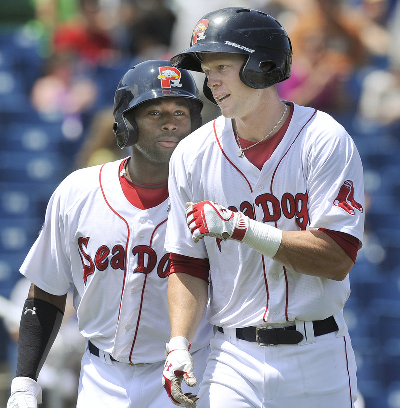 Jeremy Hazelbaker, right, heads back to the dugout with Jackie Bradley Jr. after hitting the first of his two homers Wednesday in the Sea Dogs' 12-0 win over Reading.