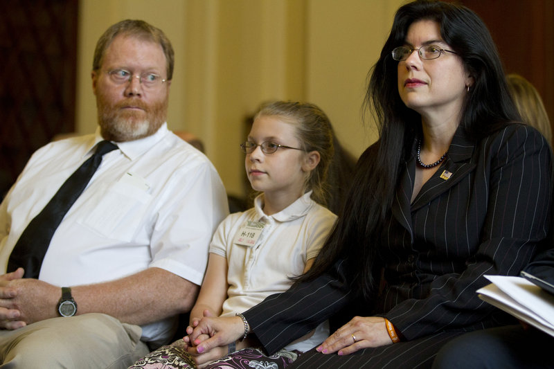 Ruth Moore, right, is accompanied by her husband, Butch Moore, and daughter Samantha on Capitol Hill Wednesday.