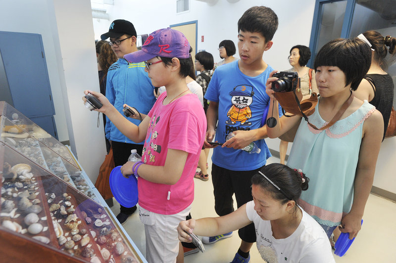 Students from the Tangshan Foreign Language School in the Hebei Province of China tour the University of New England's Marine Animal Rehabilitation Center in Biddeford this week as part of Kennebunk High School's weeklong summer camp for international students.
