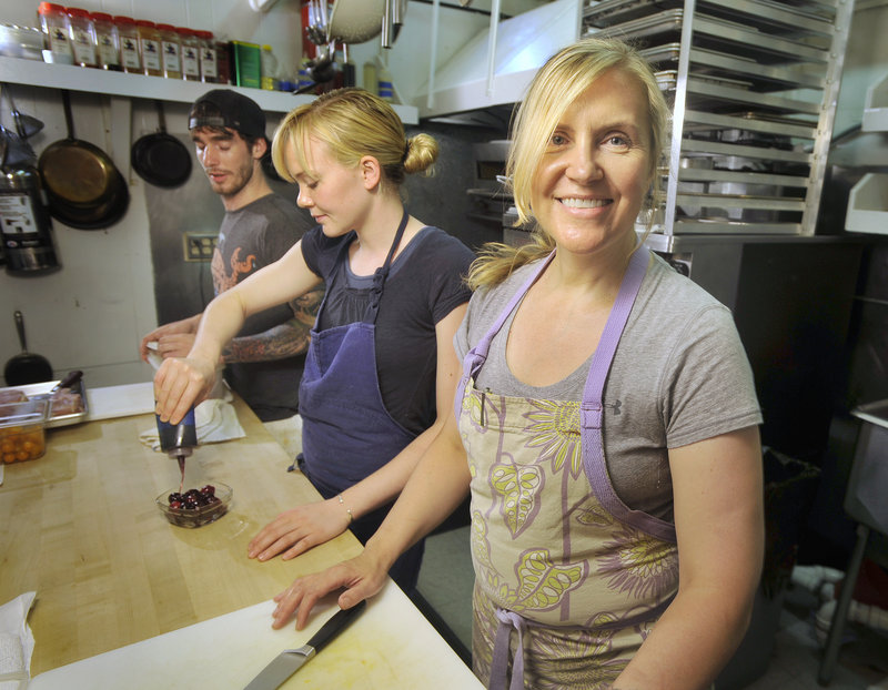 In 2010, women in food preparation and serving jobs earned 82 percent of what a man made. Krista Kern Desjarlais, front, owner of Portland's Bresca, says her line cooks, Blaine Pitcock, left, and Shelby Stevens, do the same work and earn the same pay.
