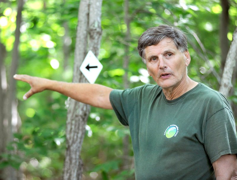 Bob Shafto, open-space ombudsman for Falmouth, gives a tour of Suckfish Brook Conservation Area on Friday. He said the land should stay the way it is for many reasons.