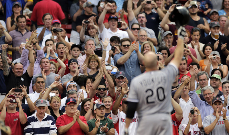 "Kevin Youkilis of the White Sox greets the crowd at Fenway Park on July 16. A reader who attended that game says that by tightening the limit on soot emissions, federal regulators could save 37,700 American lives a year, ""equivalent to a packed house at Fenway Park."""