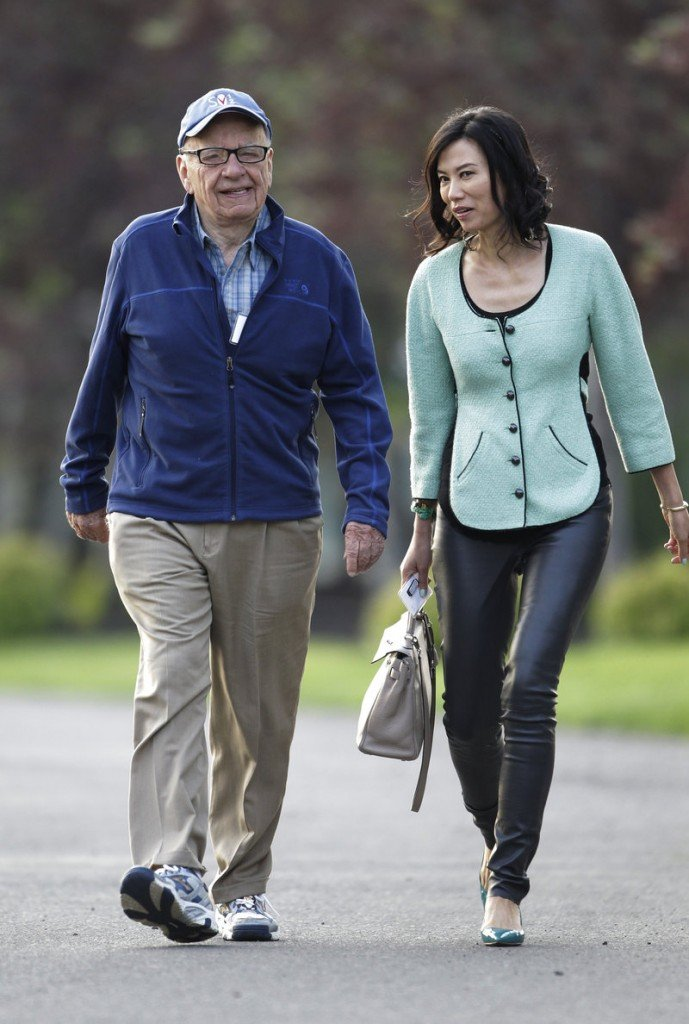 Media mogul Rupert Murdoch and his wife, Wendi, arrive at a conference in Sun Valley, Idaho, earlier this month. He stepped down last week as a director of NI Group, Times Newspaper Holdings and News Corp. Investments in the U.K. It was not immediately clear which of News Corp.'s U.S. boards he has left.