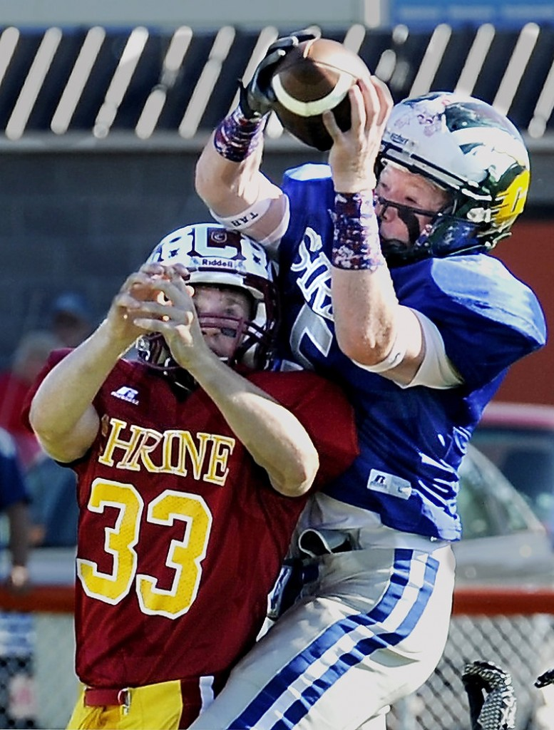 Matt Burnell of Bonny Eagle, right, hauls in a pass for the West while guarded by Wyatt Frost of Bangor during the first half Saturday in the Lobster Bowl. The West rallied for a 48-24 victory.