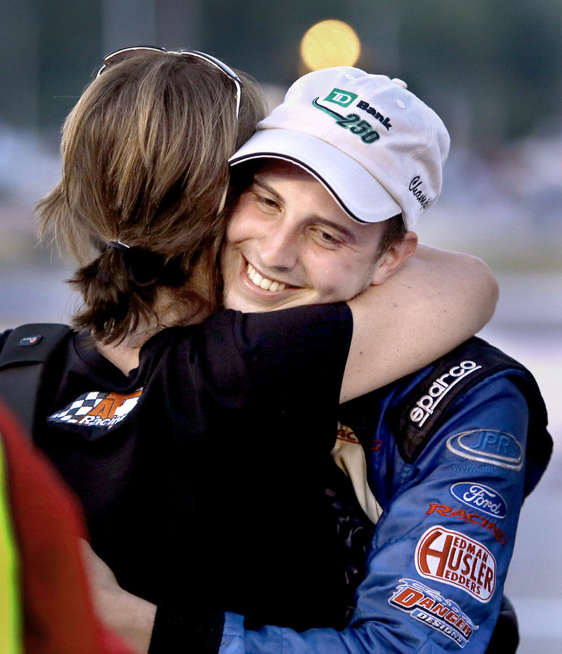 Joey Polewarczyk Jr. hugs his future mother-in-law, Terry Theriault, after winning the TD Bank 250 on Sunday. Theriault's daughter is engaged to Polewarczyk, and her son, Austin, finished third.