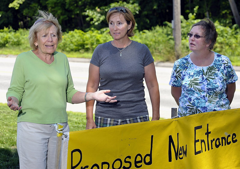 Friends of Oak Hill, from left, Joan Jagolinzer, Lisa Ronco and Stephanie Ruel discuss their concerns about the assisted living project proposed for the wooded area behind them.