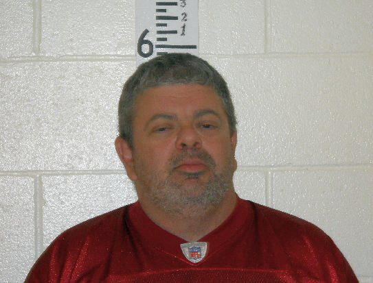 Timothy Courtois, who was arrested Sunday, says he took a gun into a Saco theater showing the new Batman movie.
