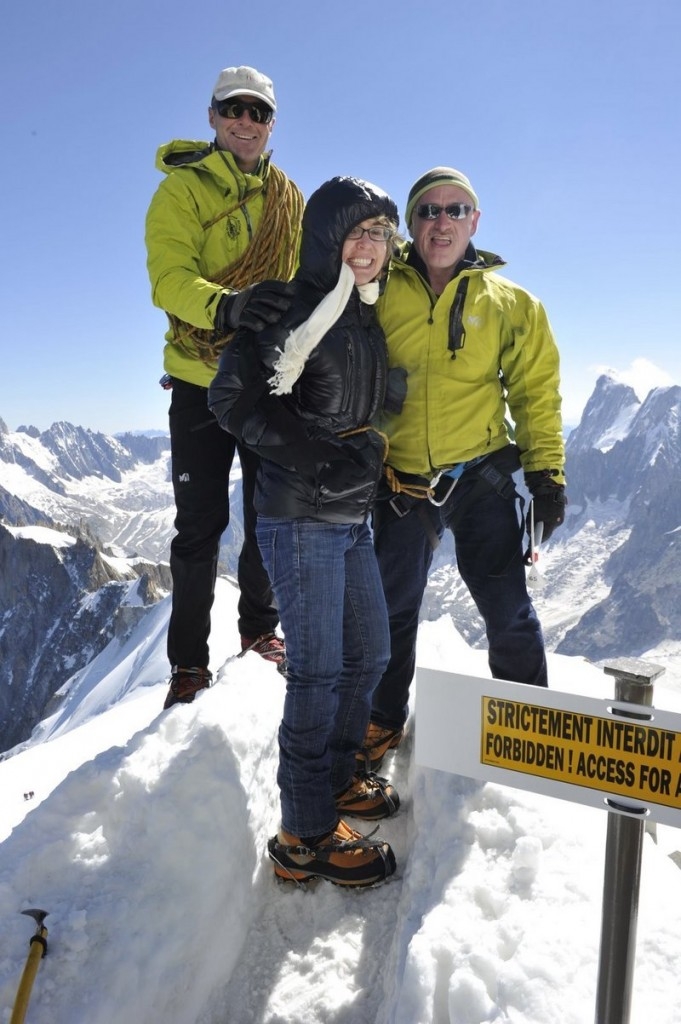 Former U.S. congresswoman Gabrielle Giffords and her husband Mark Kelly, right, along with a guide in the French Alps on Monday.