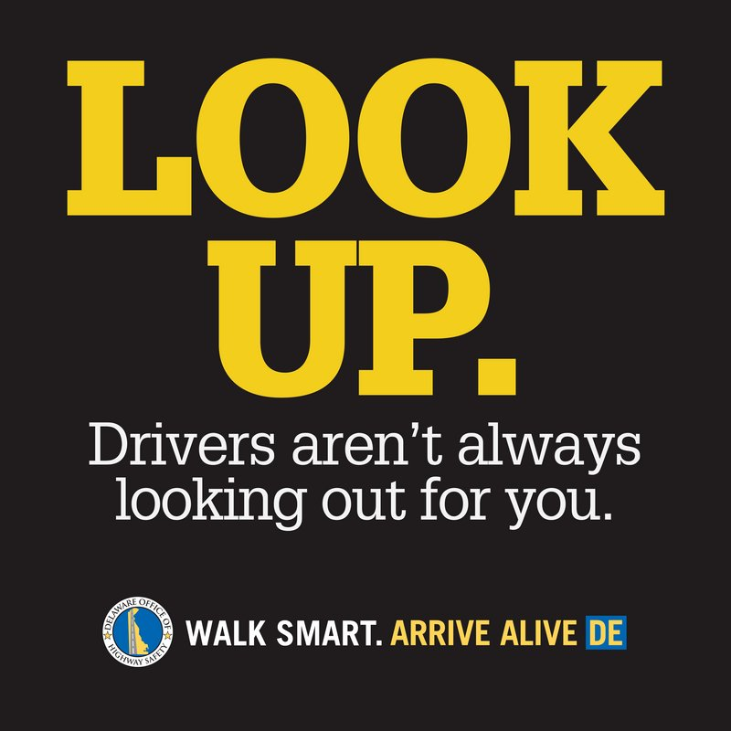 Highway safety officials in Delaware place this 2-foot-square decal on crosswalks and sidewalks to remind pedestrians to change focus.