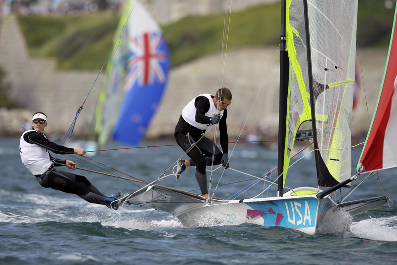 Erik Storck and Trevor Moore of the United States are ninth in a 20-boat regatta that will continue through Aug. 8 at the Olympics. Their coach is Dave Hughes, a Yarmouth native and University of Southern Maine graduate who fell in love with the sport as a middle-school student.