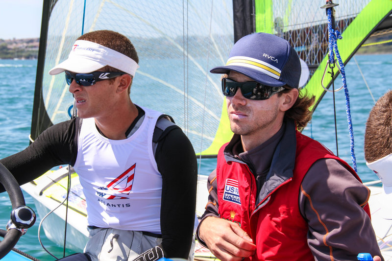 Dave Hughes, right, isn't allowed to talk with his crew members during an Olympic event, but prepares them before each race and goes over everything that happened afterward.