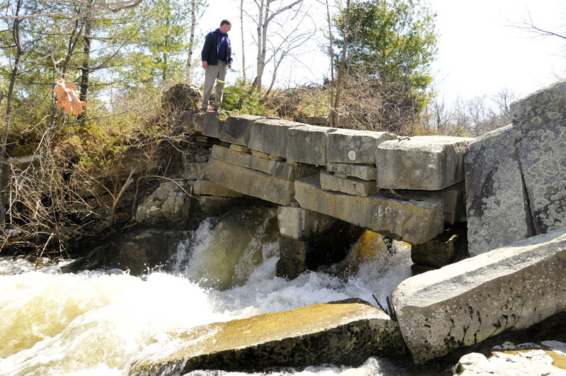 Courtesy TJD&A Taken in April 2008, this is one of the last known photos of the former granite bridge to Factory Island on the Royal River in Yarmouth. Tom Farmer, a landscape architect at Terrence J. DeWan & Associates in Yarmouth, was studying the area for a river corridor plan. The bridge, likely built decades ago as a dam with wooden spillways, collapsed into the river sometime after 2008.