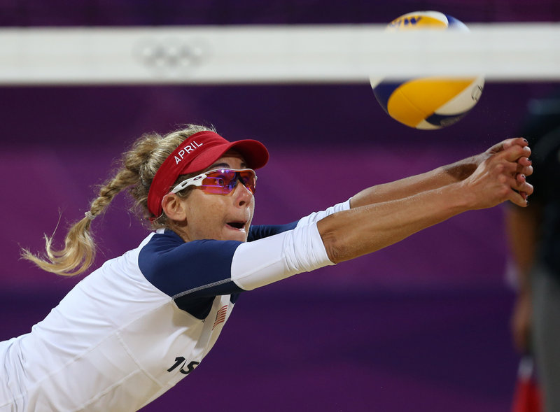 April Ross of the United States stretches for a ball during the three-set beach volleyball victory against the Netherlands. The U.S. men also won, in two sets.