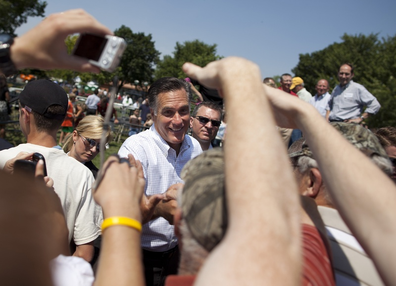 Supporters of former Massachusetts Gov. Mitt Romney reach out to shake his hand during a campaign stop in Council Bluffs, Iowa, earlier this summer. Both Romney and President Obama seem to have different definitions of the middle class.