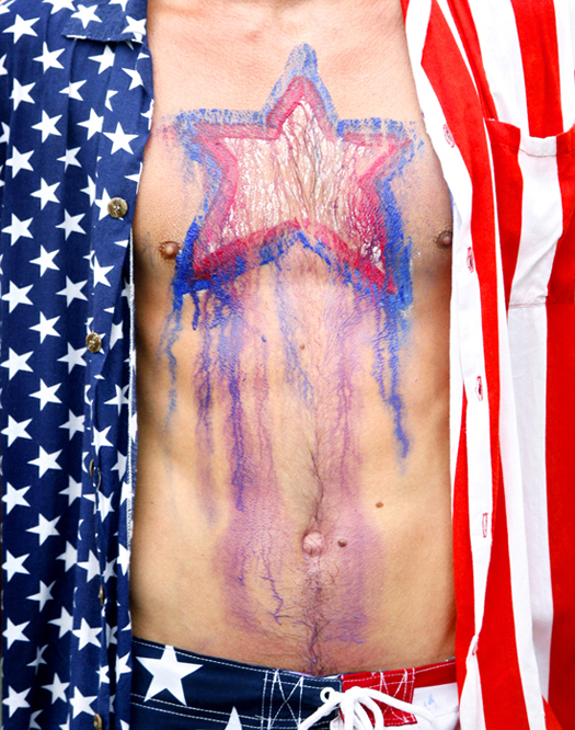 Rain and sweat caused the paint on the chest of Conrad Bollinger of St. Louis, Mo., to streak while running in the Four on the Fourth road race in Bridgton today.