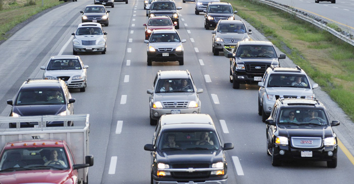 This August 2010 file photo shows traffic on the Maine Turnpike. Researchers say Fourth of July traffic in Maine will be reduced by half this year because it falls on a Wednesday.